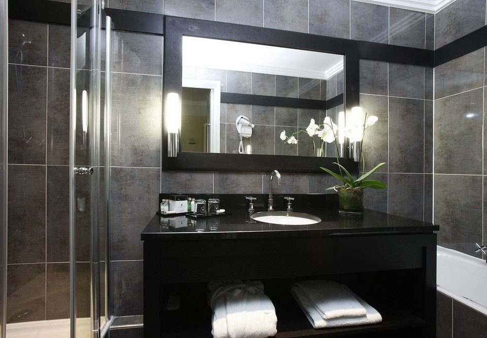 bathroom property countertop sink lighting cabinetry Kitchen glass tile flooring Modern public tiled