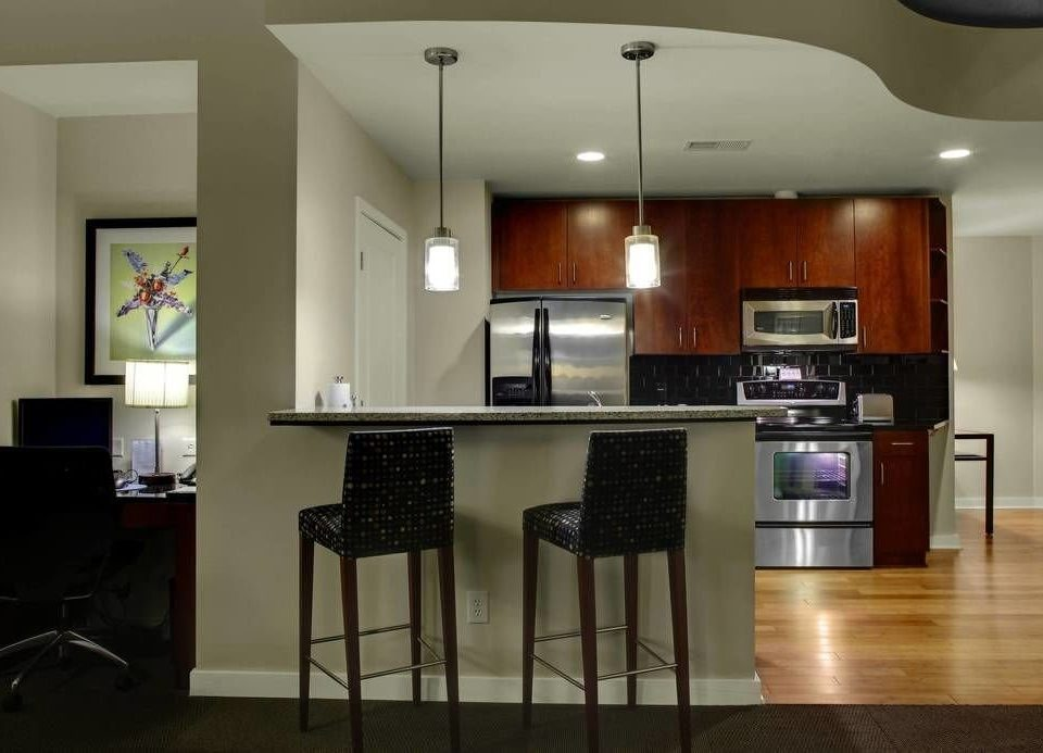 property Kitchen cabinetry hardwood home living room lighting flooring wood flooring countertop stainless Modern