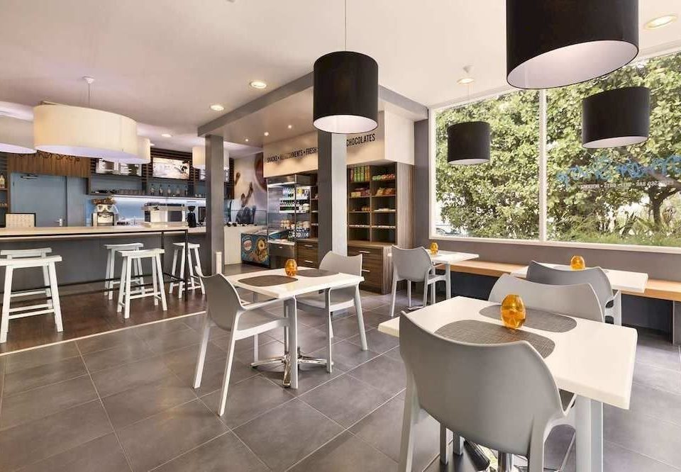 chair property condominium home living room Kitchen loft Modern dining table