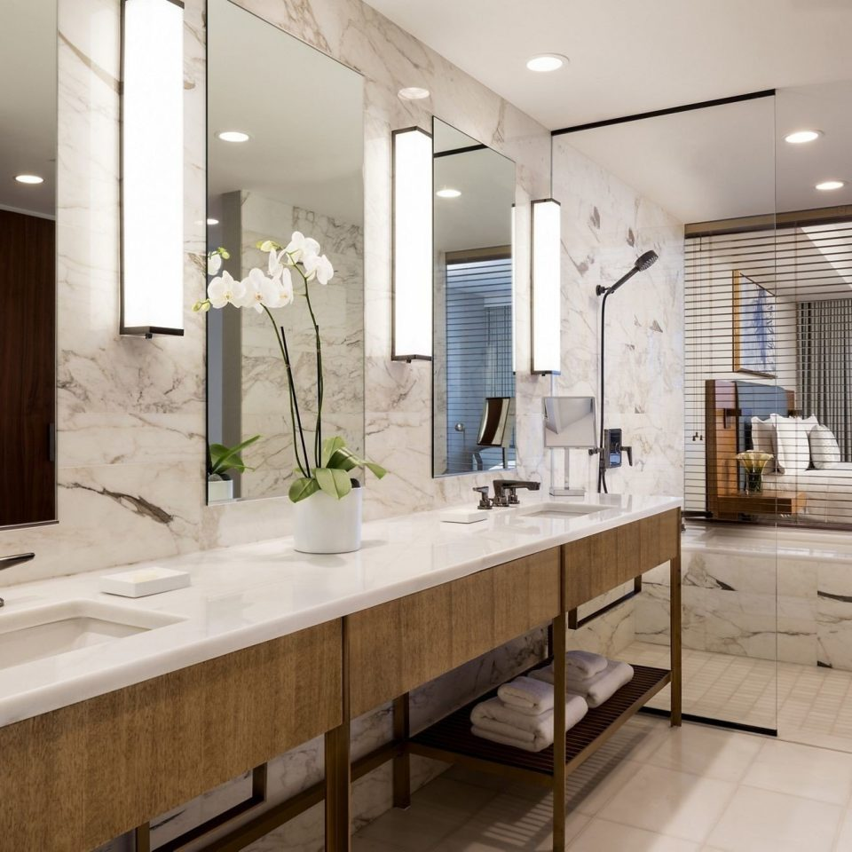 bathroom sink mirror property home cabinetry Suite Kitchen counter countertop flooring big condominium long tile Modern tub