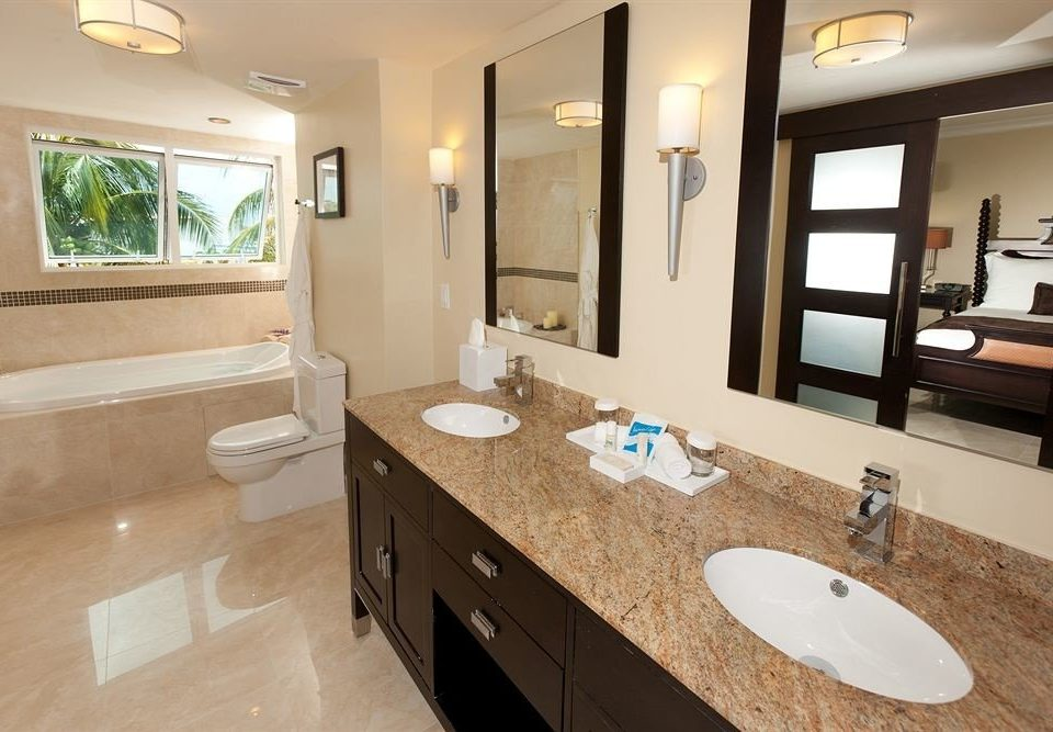 bathroom property sink home countertop Kitchen cottage cabinetry Suite Modern tan