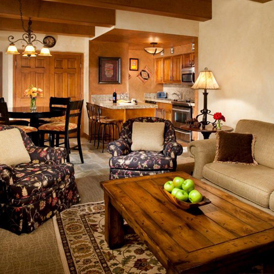 Kitchen Resort property living room home Suite cottage hardwood recreation room Villa