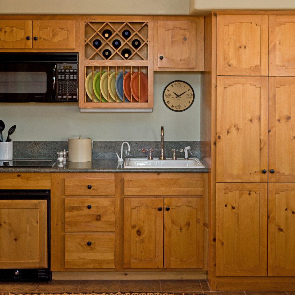 cabinet Kitchen Rustic wooden cabinetry cupboard sideboard hardwood chest of drawers wood stain appliance