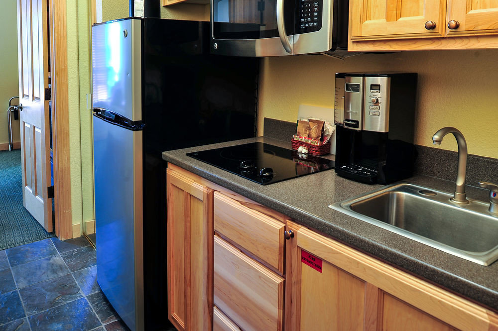 cabinet Kitchen property countertop cabinetry home cottage oven Suite stove counter steel kitchen appliance appliance stainless microwave