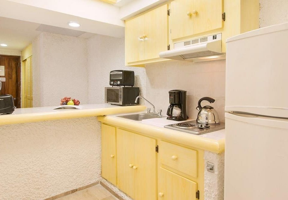 cabinet Kitchen white property home yellow countertop cottage cabinetry cuisine Suite appliance kitchen appliance