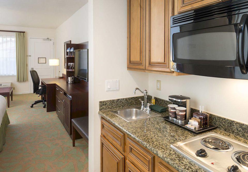 Kitchen property home cuisine classique cottage countertop Suite condominium kitchen appliance stove appliance