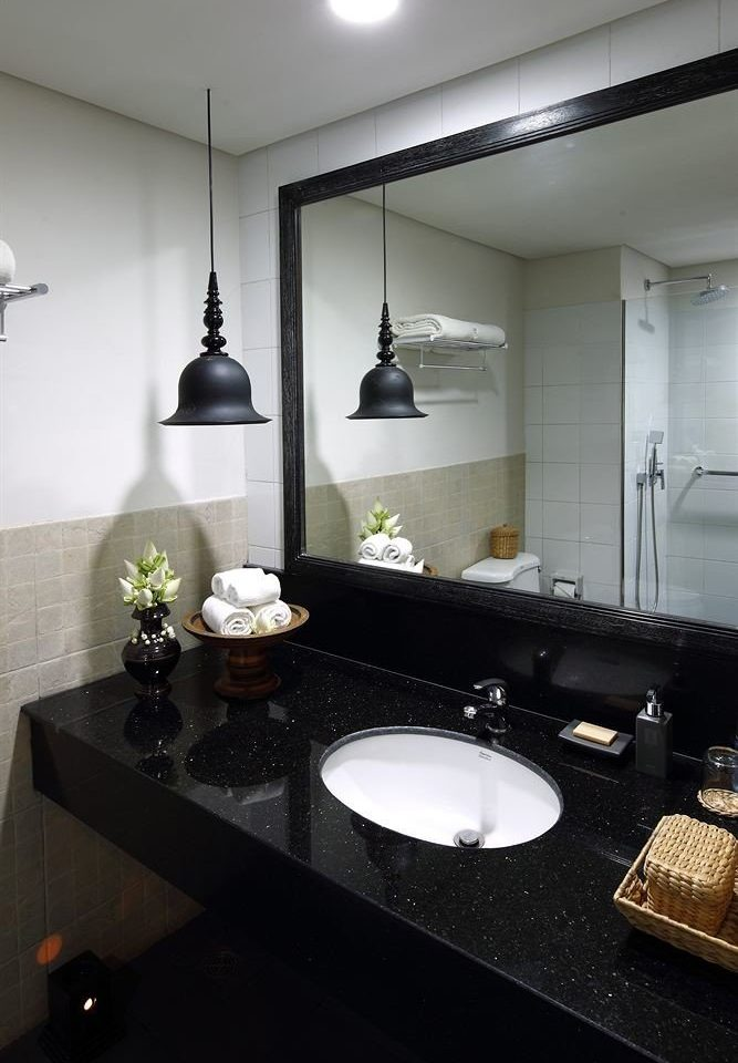 bathroom sink property counter countertop home black lighting Kitchen Suite living room flooring