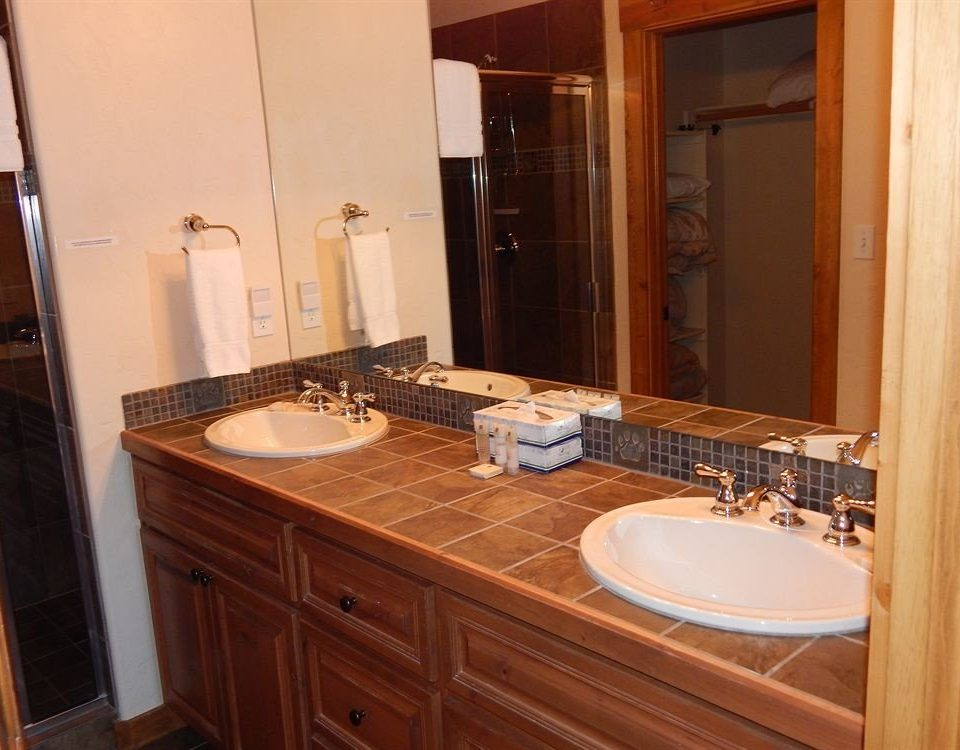 cabinet bathroom sink property cabinetry home cottage counter countertop Kitchen Suite tile