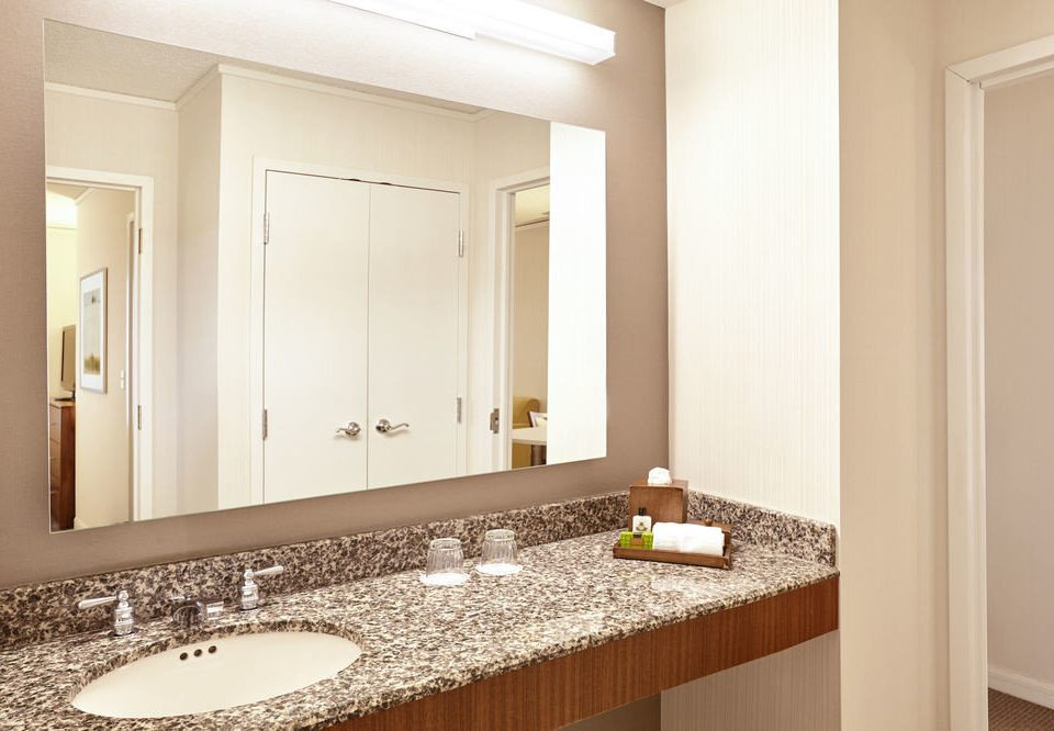 bathroom mirror sink property countertop Kitchen home cabinetry counter flooring plumbing fixture Suite