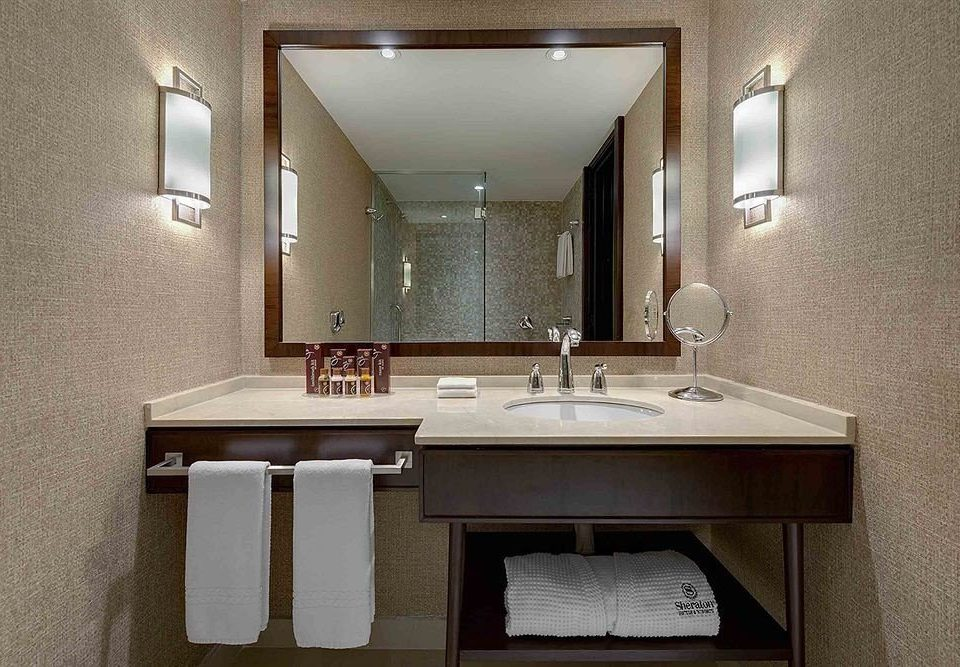 bathroom mirror sink property home lighting countertop Suite towel Kitchen cottage vanity cabinetry plumbing fixture tan tile