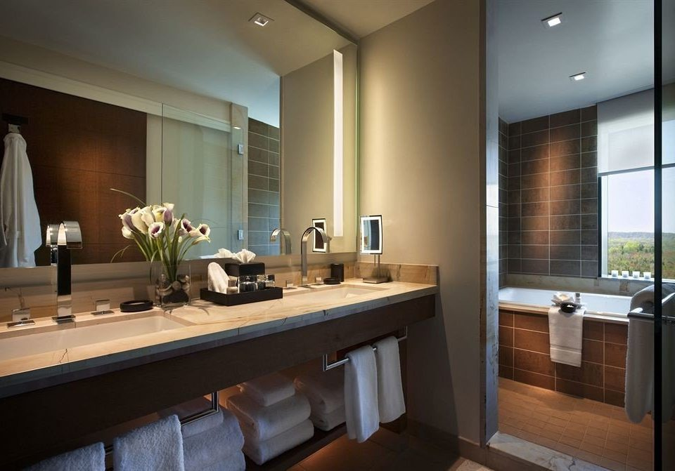 bathroom sink mirror property counter Suite home lighting condominium cabinetry Kitchen
