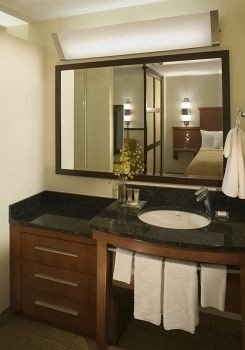 bathroom mirror property sink countertop cabinetry home Suite cottage Kitchen