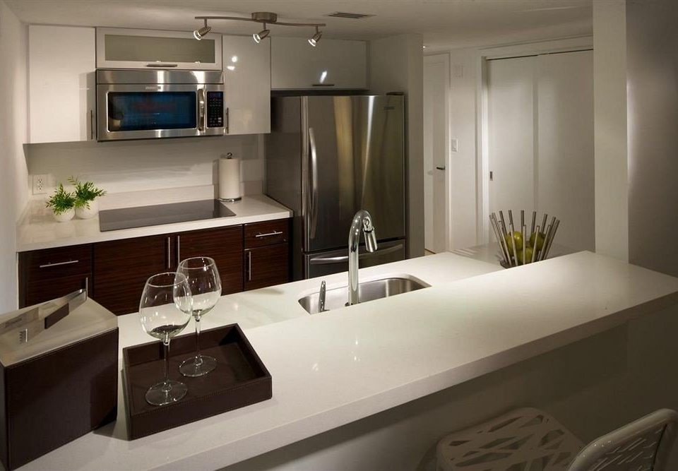 property Kitchen home countertop counter cabinetry cottage Suite bathroom kitchen appliance