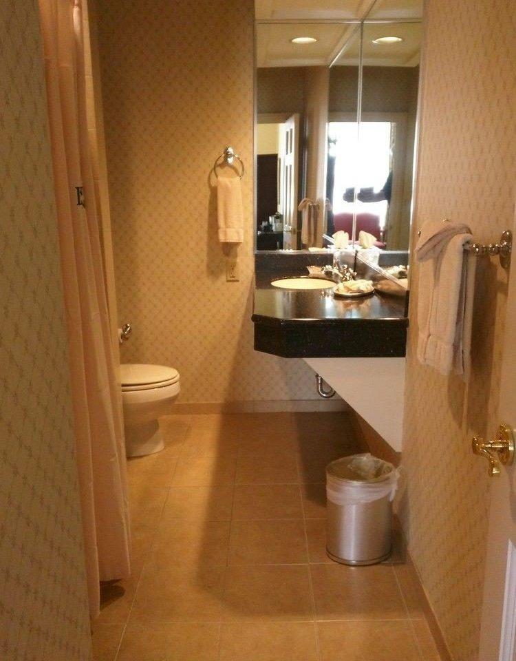 bathroom property toilet sink home hardwood cabinetry Kitchen flooring countertop cottage Suite tile tiled