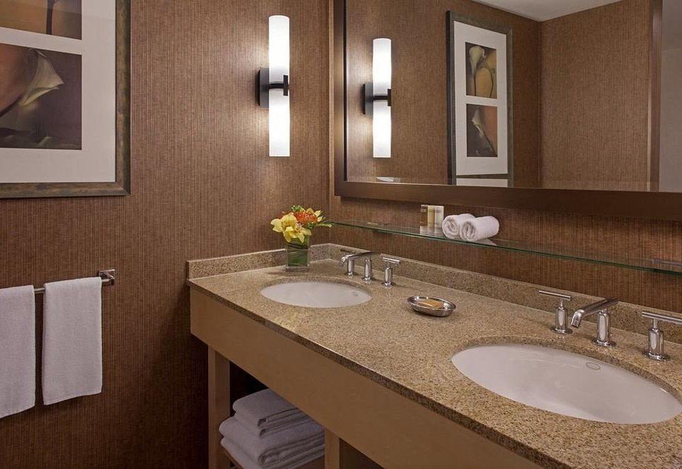 bathroom sink mirror property countertop counter home Suite vanity towel toilet cottage flooring Kitchen clean tan