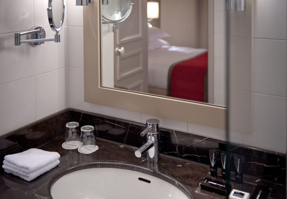 bathroom sink mirror toilet property home countertop house Kitchen flooring plumbing fixture Suite cottage public tile
