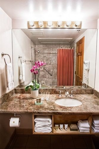 bathroom property sink home countertop Suite lighting Kitchen living room counter toilet