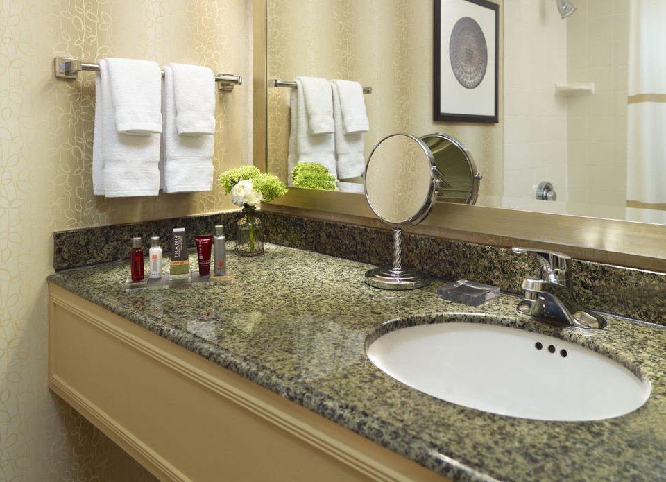 bathroom sink mirror property counter countertop towel toilet home flooring material Kitchen Suite vanity
