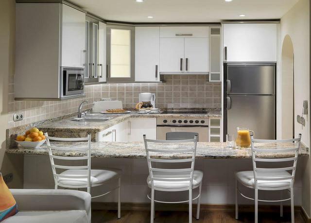 property Kitchen home countertop cabinetry cuisine classique living room condominium cottage Suite flooring dining table