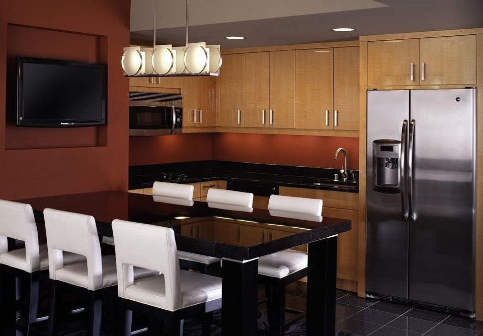 Kitchen property cabinetry home Suite stainless kitchen appliance