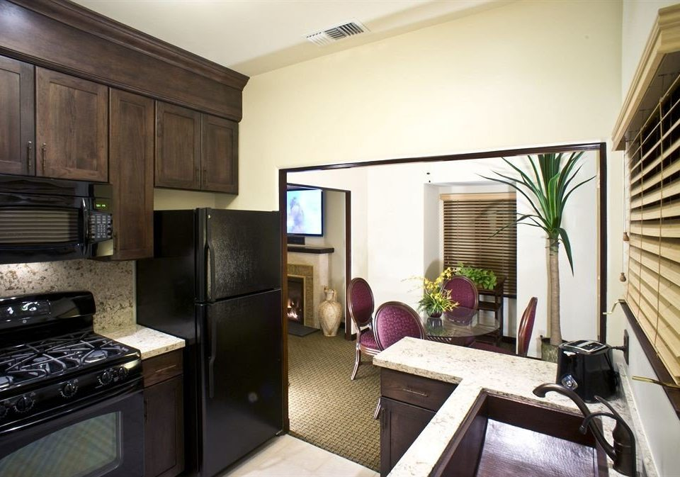 Kitchen cabinet property home condominium stove living room Suite cottage Villa appliance stainless steel kitchen appliance
