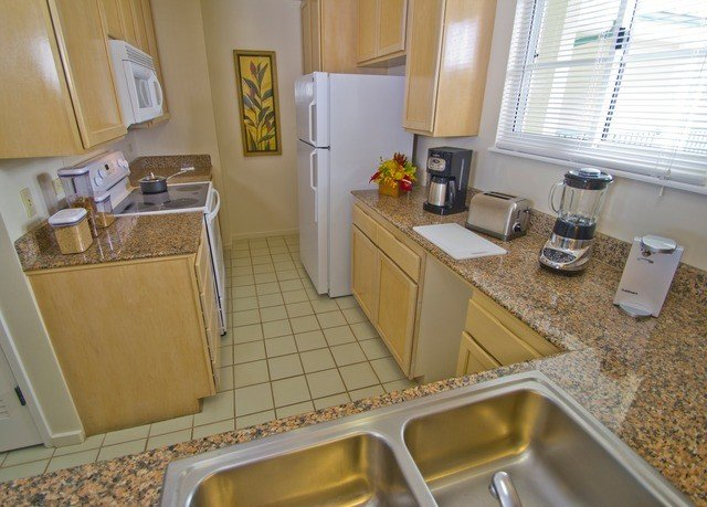 Kitchen property countertop home cottage bathroom counter Villa Suite flooring oven appliance kitchen appliance tiled