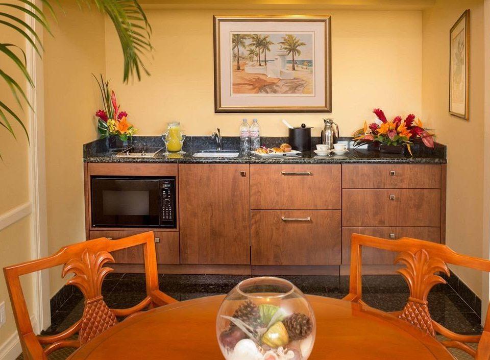 property home cottage Suite living room orange cabinetry Kitchen Villa plant dining table