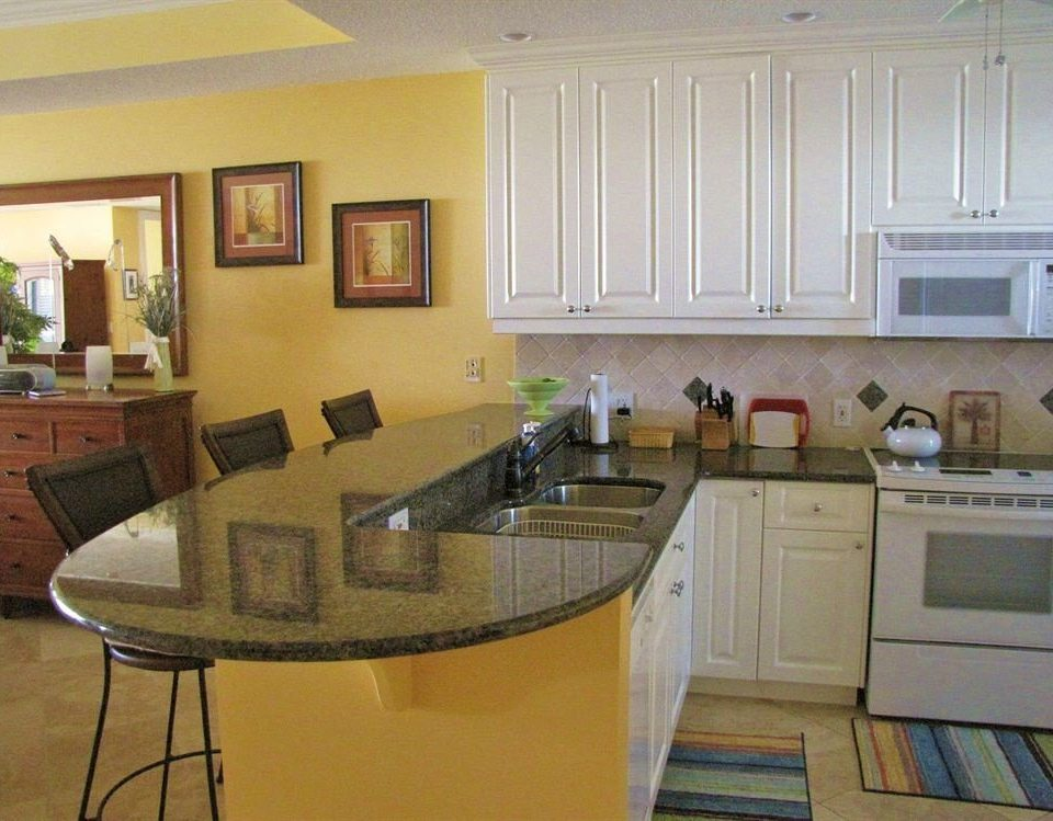 Kitchen property home countertop cottage hardwood condominium cabinetry cuisine classique living room Villa kitchen appliance