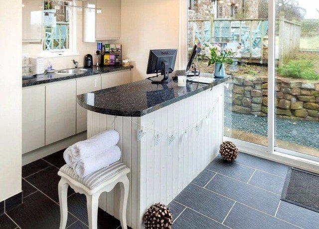 property Kitchen countertop home hardwood flooring cottage wood flooring counter Villa tile tiled