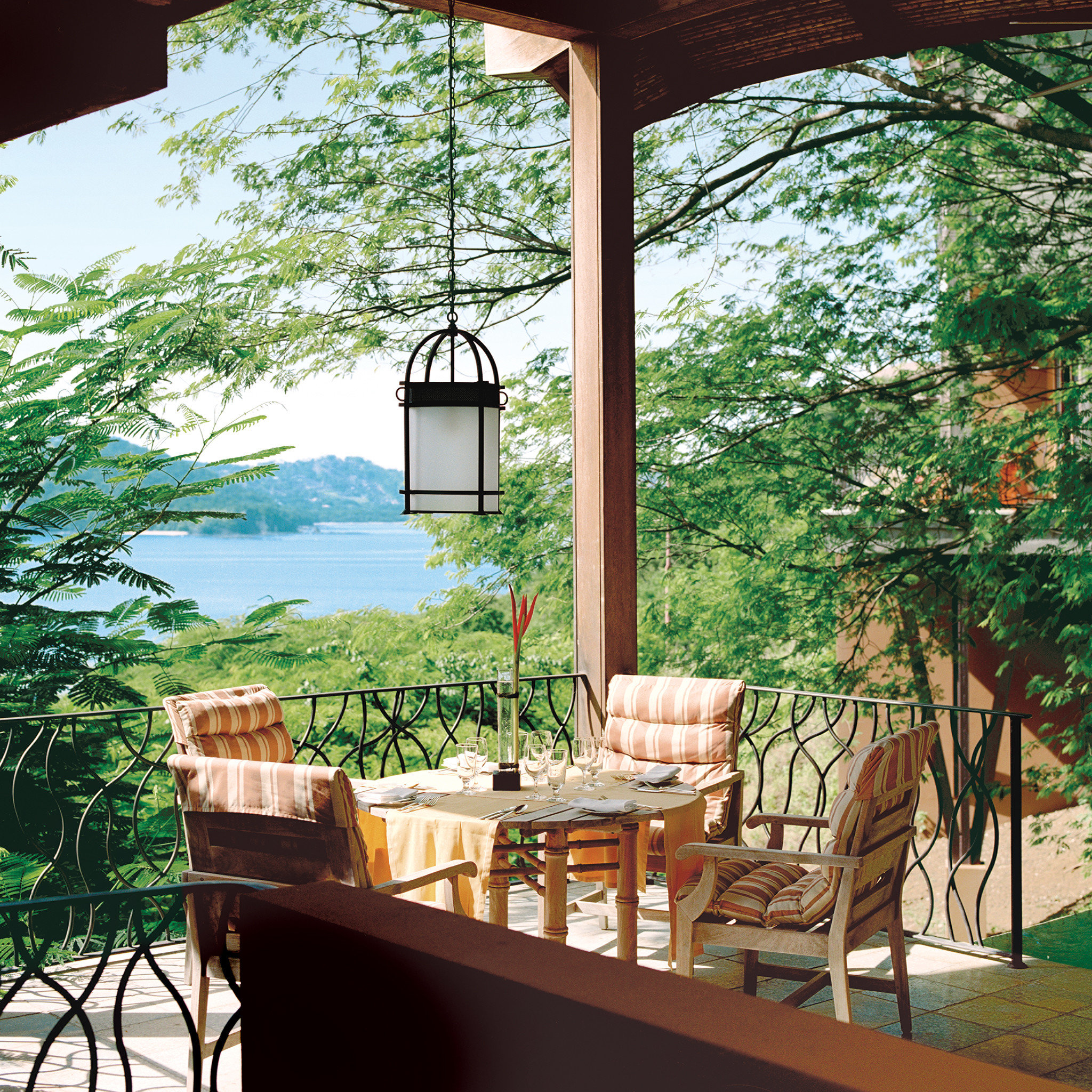 Beach Hotels Living Lounge Luxury Ocean Scenic views tree table outdoor property building house estate backyard home Courtyard outdoor structure Villa cottage interior design Resort porch Garden yard furniture area