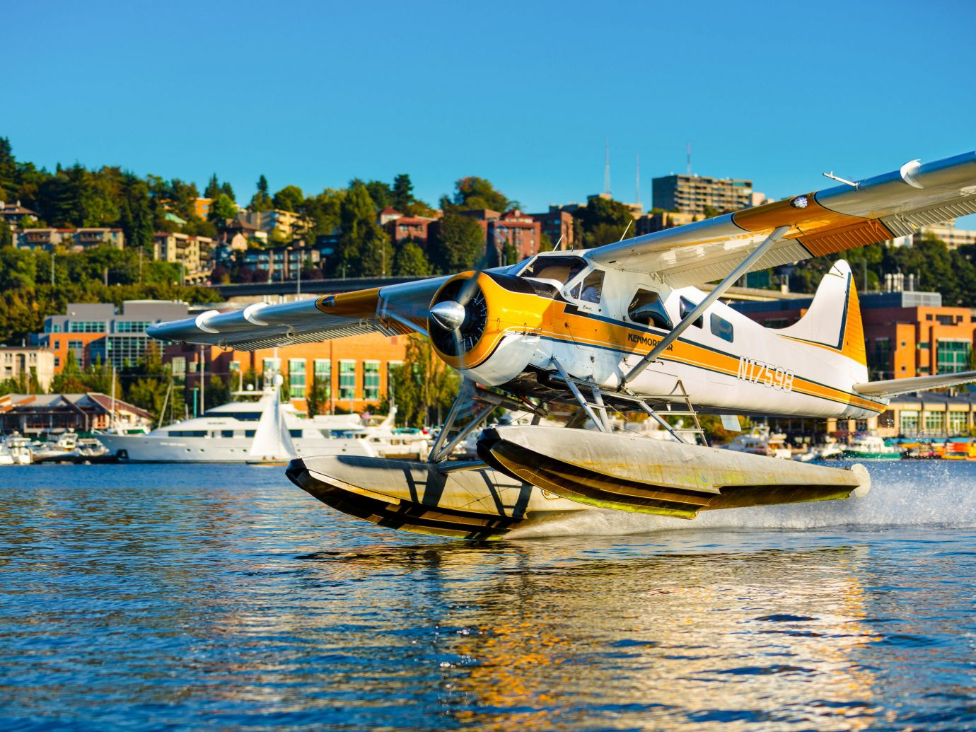 Trip Ideas sky outdoor water seaplane airplane water transportation aircraft Boat waterway atmosphere of earth light aircraft yellow leisure reflection boating aviation Harbor