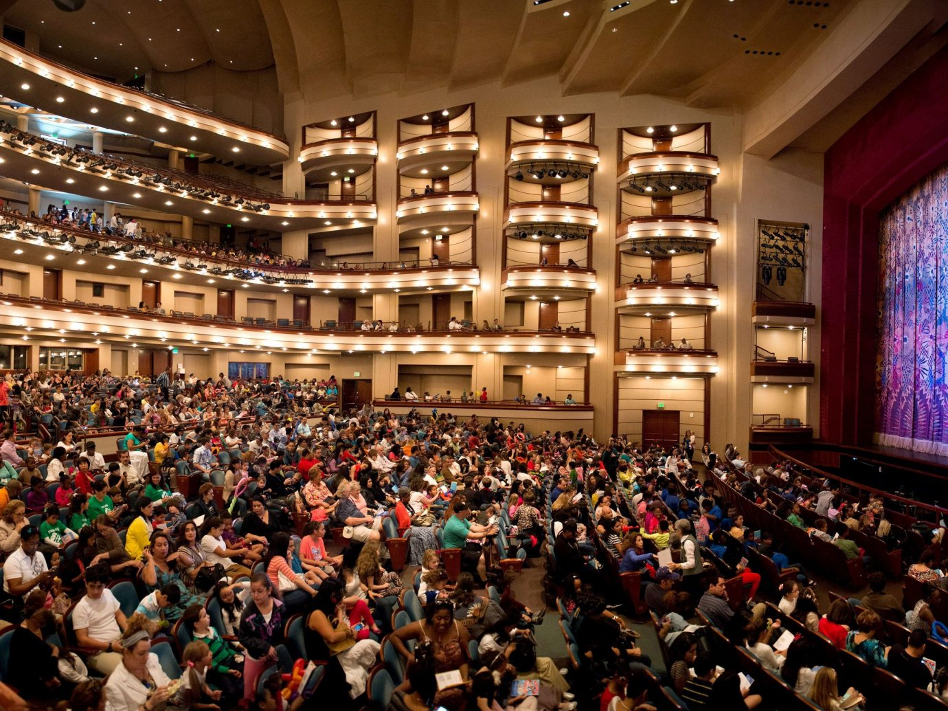 Budget indoor person ceiling crowd audience people auditorium stage musical theatre theatre convention hall