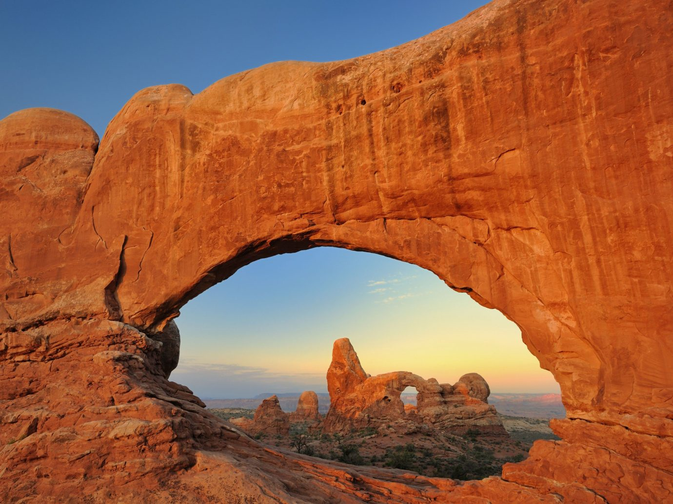 National Parks Outdoors + Adventure Trip Ideas mountain Nature valley rock outdoor canyon arch geographical feature landform broken arch natural arch butte cliff wadi geology landscape terrain badlands formation plateau Sunset national park stone hillside