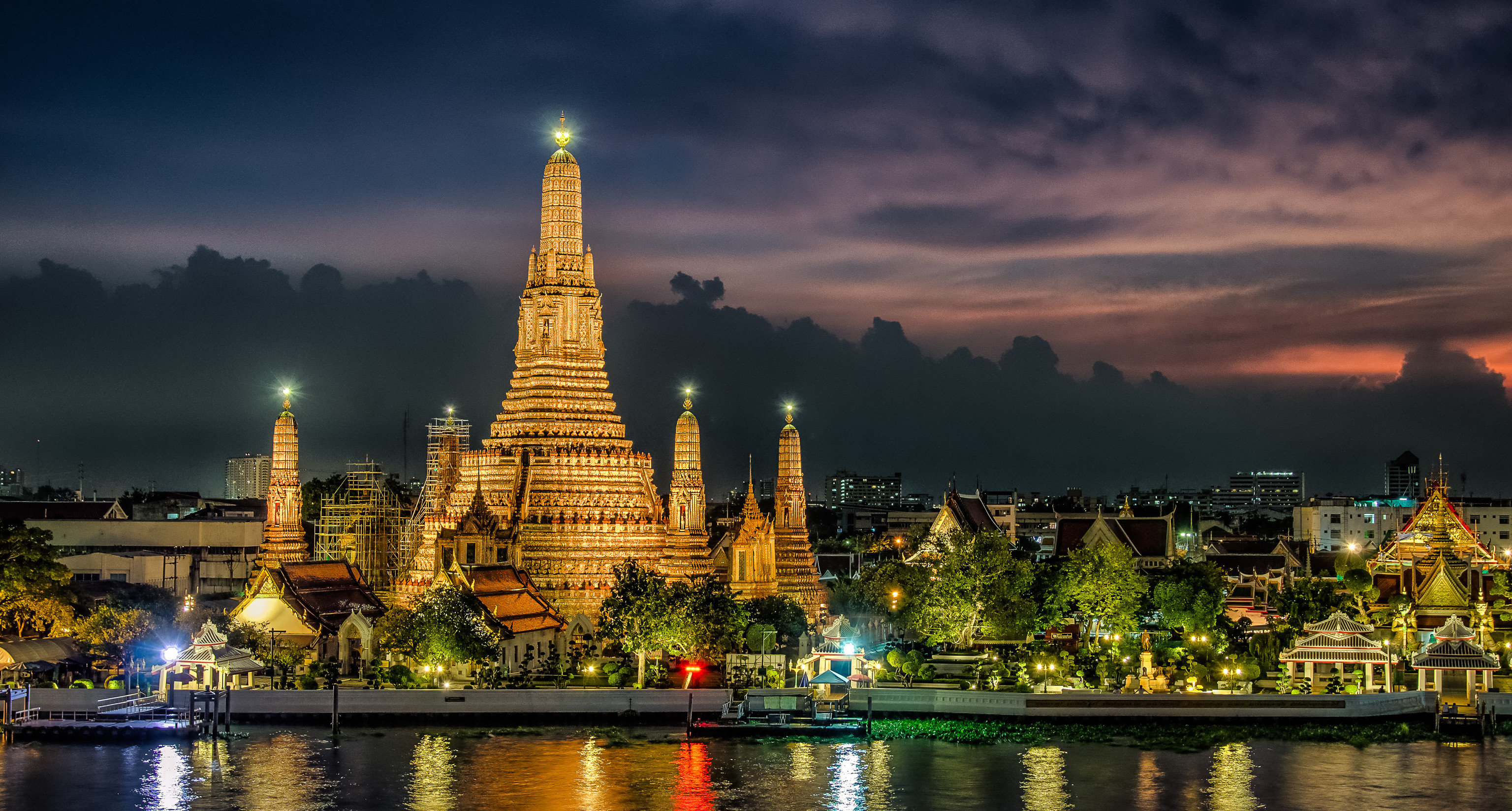 Hotels water sky outdoor River landmark night reflection City cityscape human settlement evening temple skyline dusk pagoda place of worship tower wat cloudy
