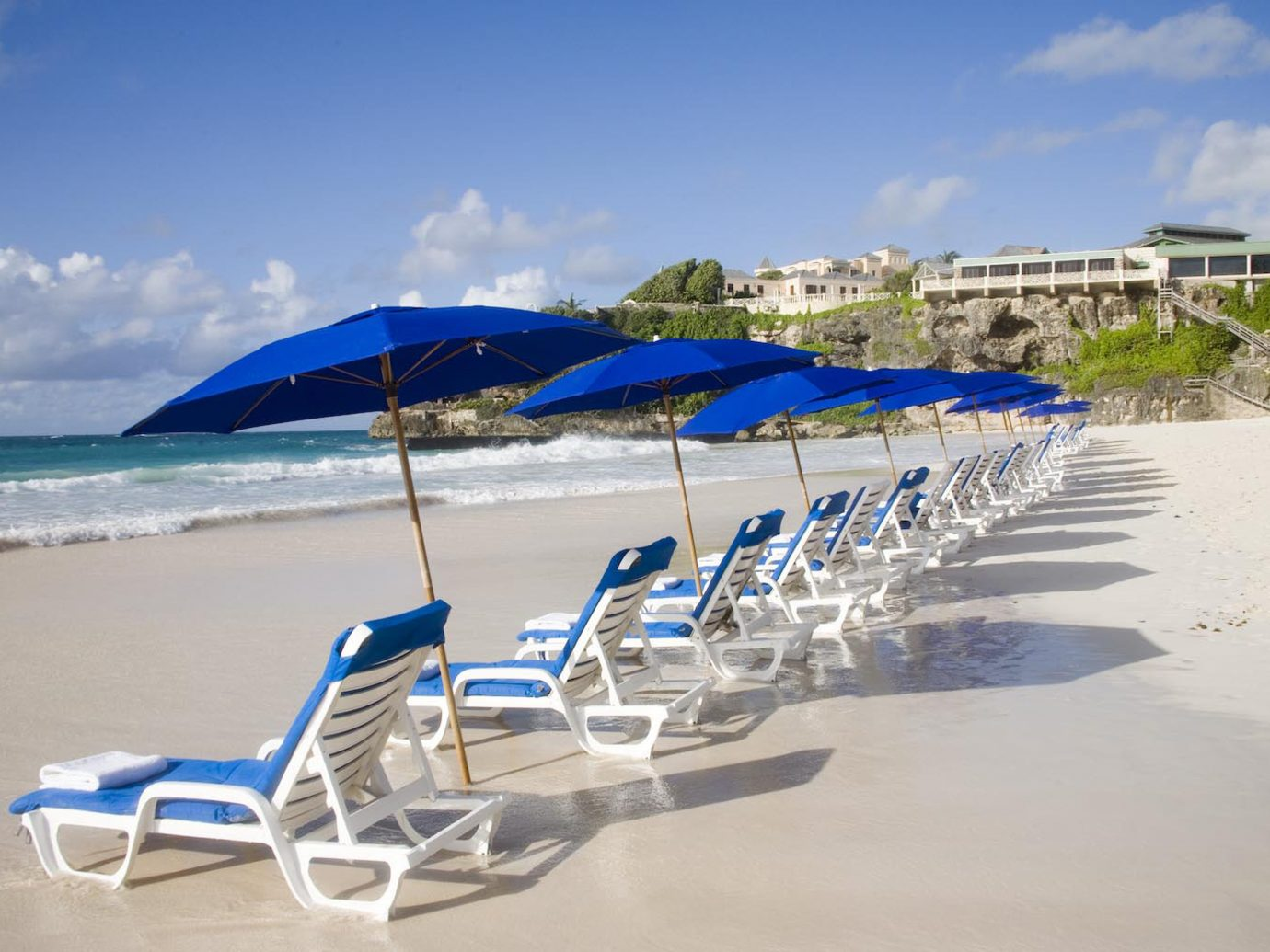 All-Inclusive Resorts Beach Beachfront Grounds Hotels Play Resort Scenic views Trip Ideas sky outdoor umbrella chair shore Sea Ocean Nature Coast vacation marina blue vehicle caribbean dock bay wind accessory day sandy