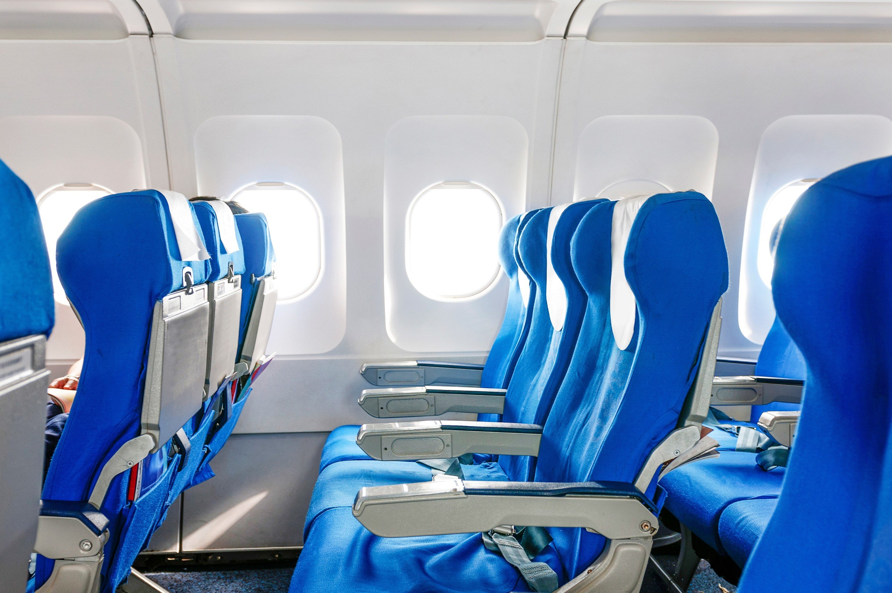 Hotels News Travel Tips Trip Ideas Cabin airline blue chair room scene aircraft cabin vehicle passenger aviation lined van