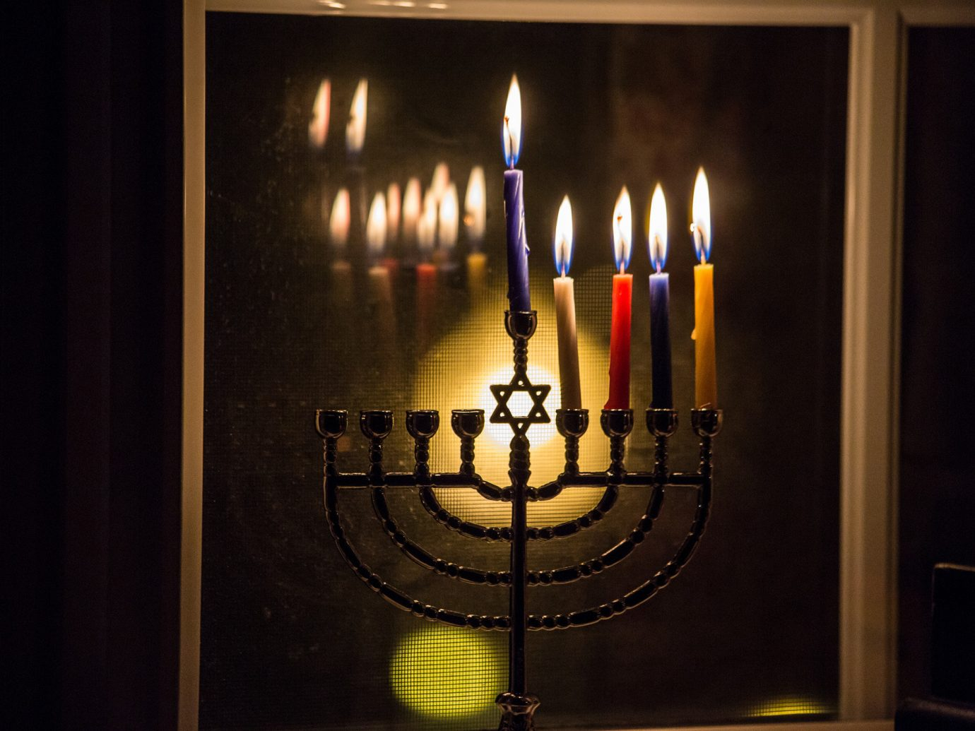 Trip Ideas candelabrum indoor candle light darkness lighting lit glass symmetry hanukkah