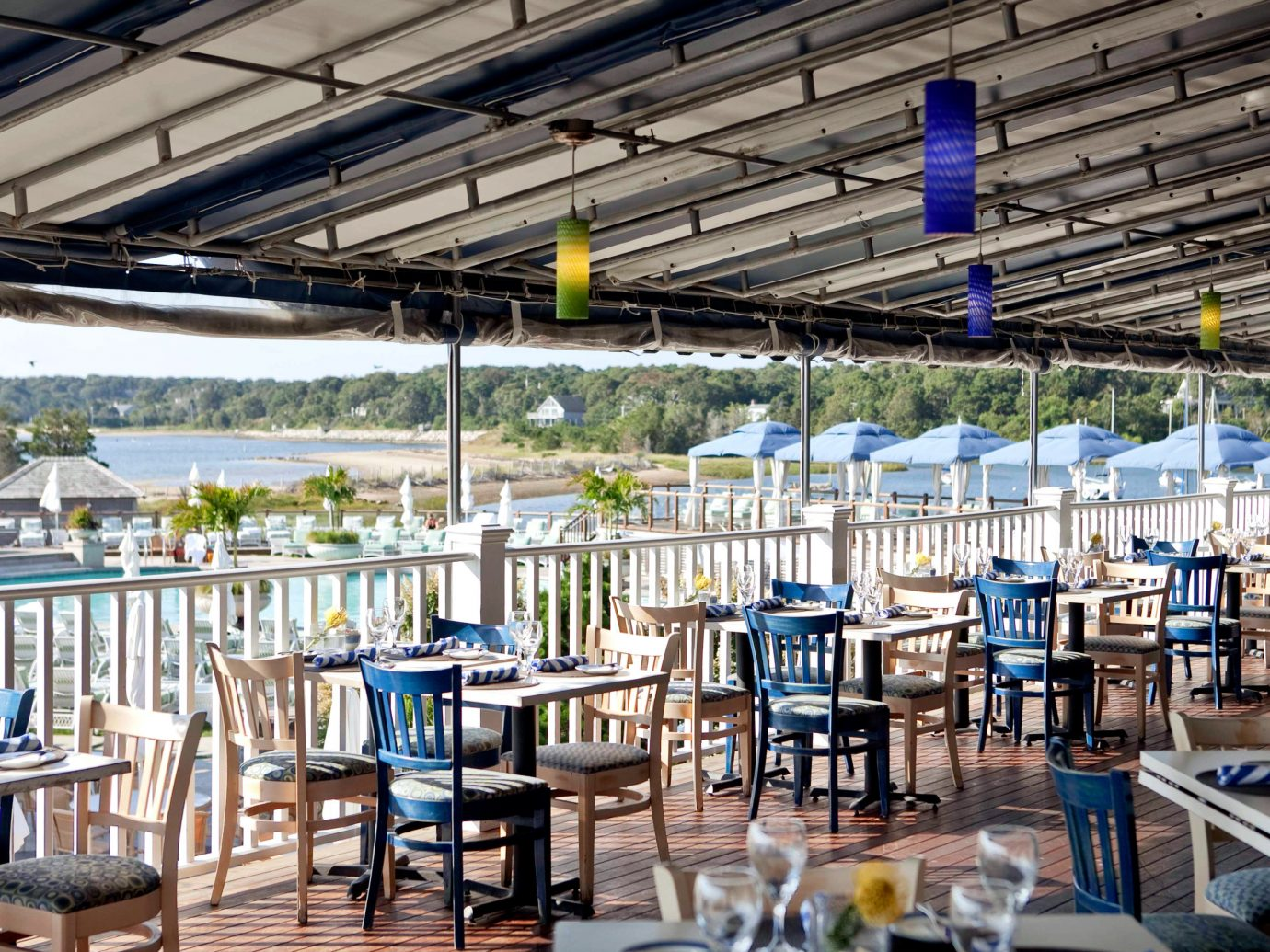 Balcony Deck Dining Drink Eat Food + Drink Hotels Living Lounge Luxury Travel Patio Resort Terrace Trip Ideas Weekend Getaways chair meal restaurant several