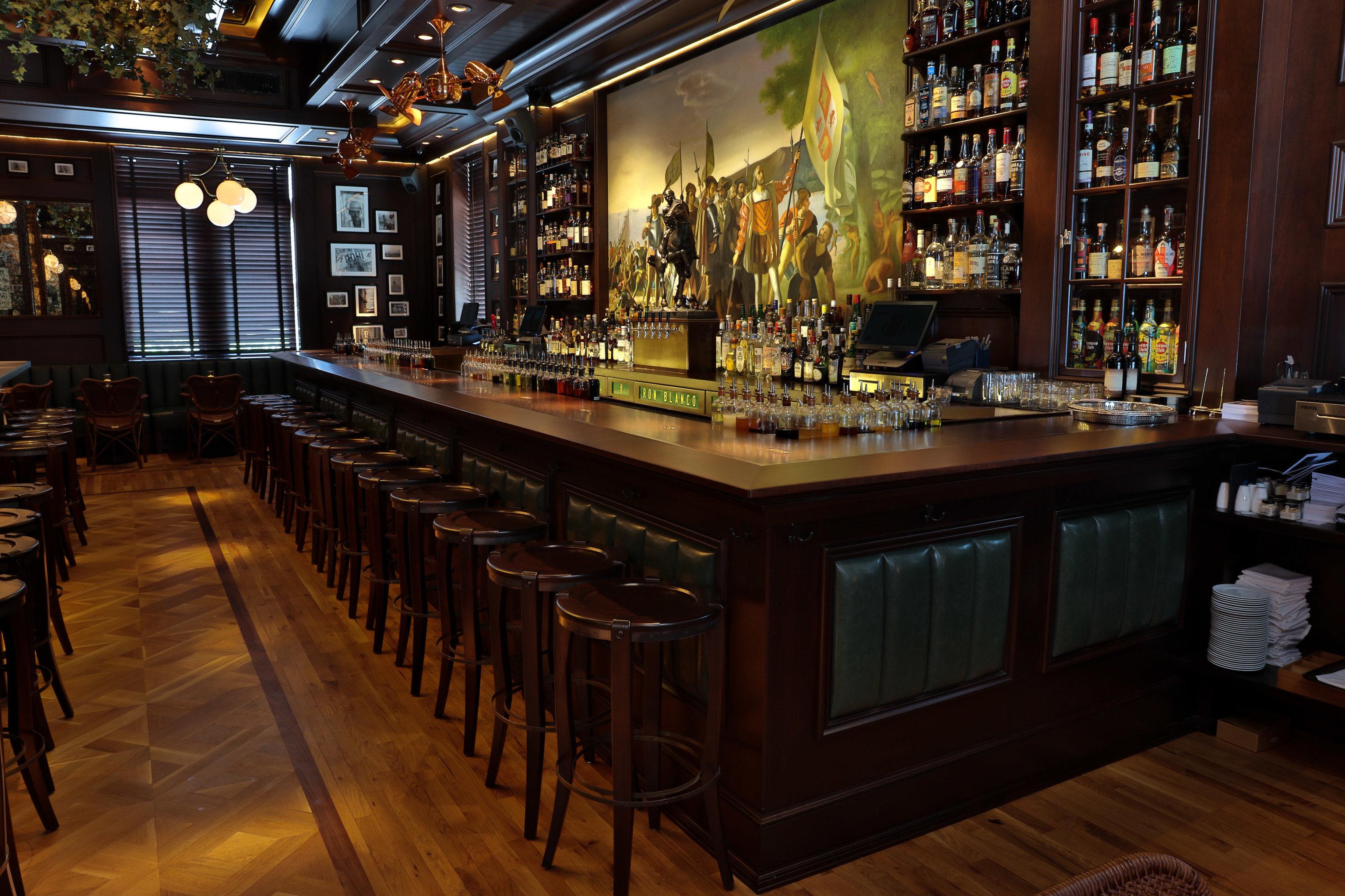 Food + Drink floor indoor Bar shelf estate interior design restaurant store dining room