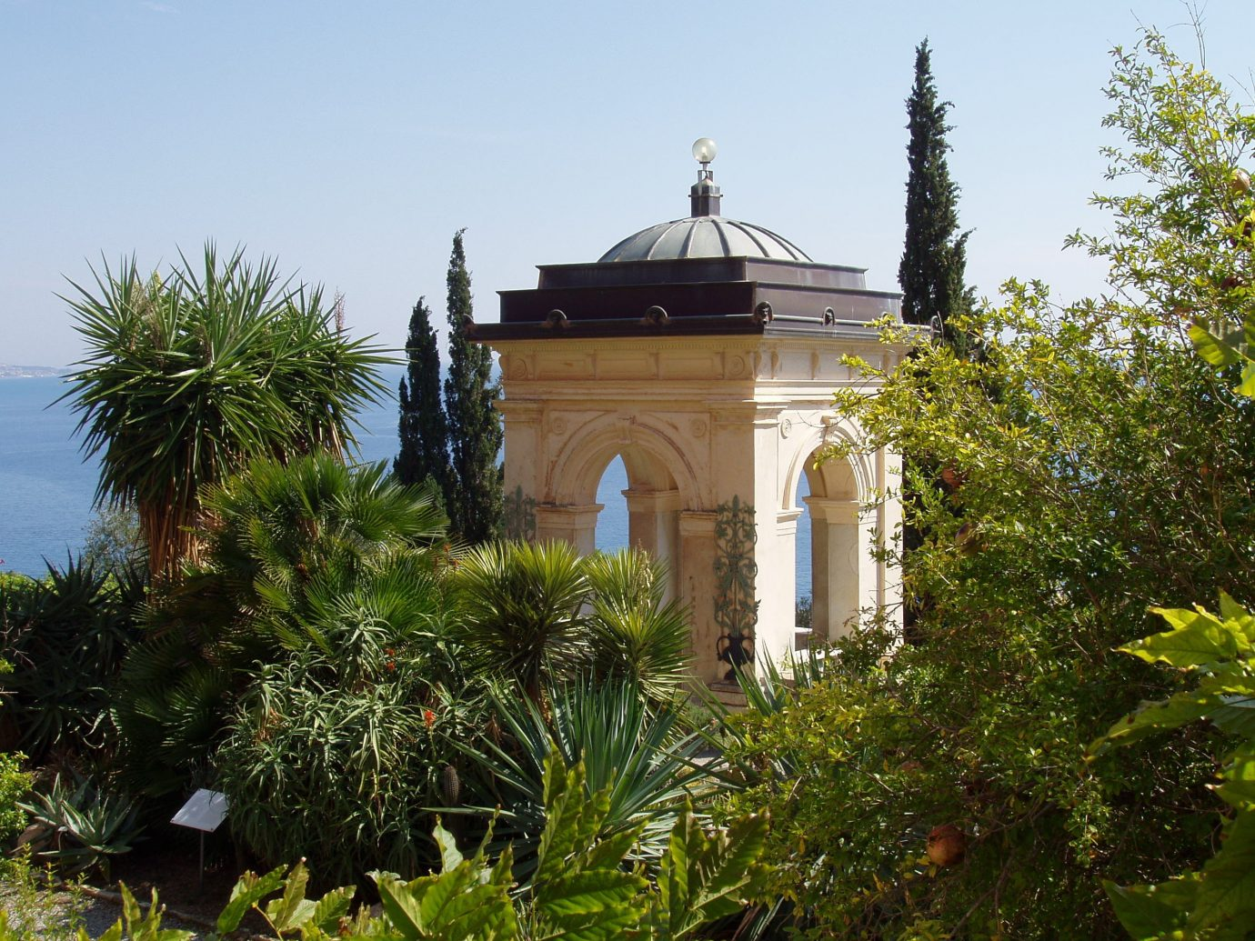 Italy Trip Ideas arecales palm tree estate sky tree plant Villa real estate building mansion house home facade outdoor structure Garden mausoleum chapel