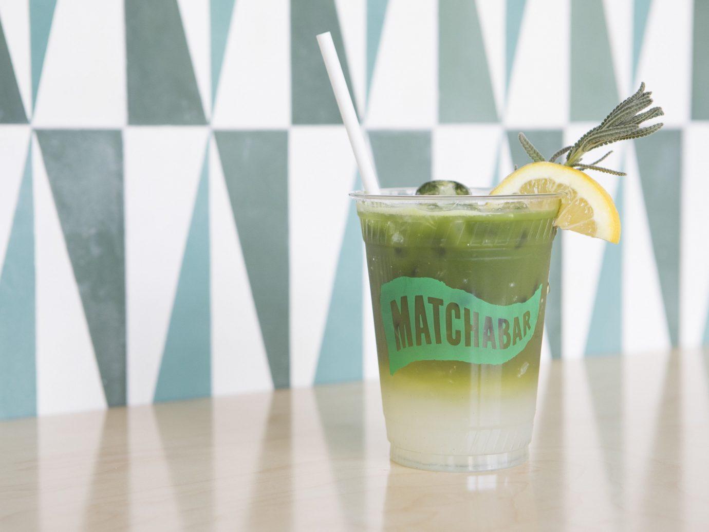cup table food Drink green beverage cocktail liqueur brand distilled beverage fruit drink glass