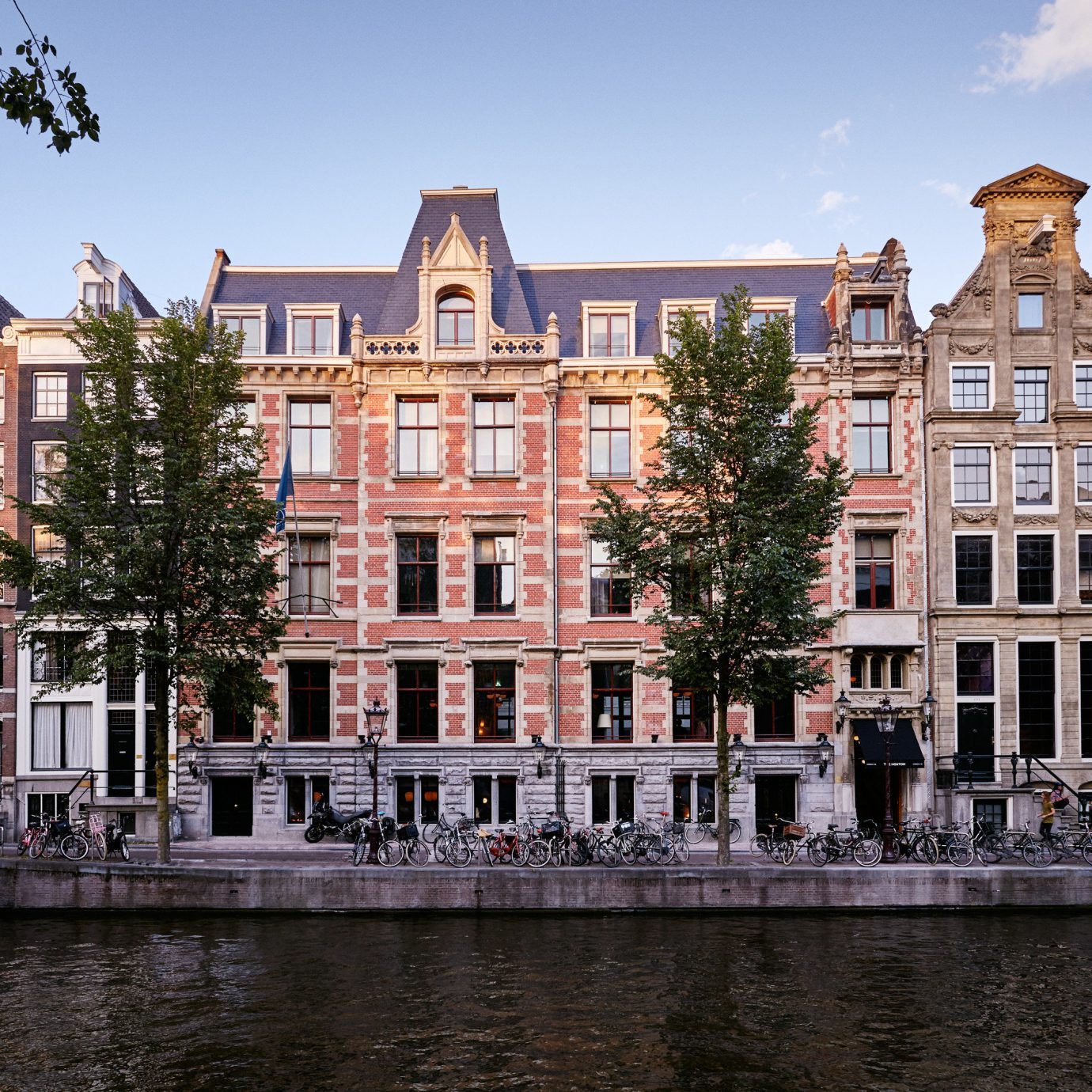 Amsterdam Boutique Hotels Hotels The Netherlands building sky water outdoor Canal landmark City waterway Town urban area neighbourhood human settlement Architecture house River cityscape Downtown estate facade town square surrounded several