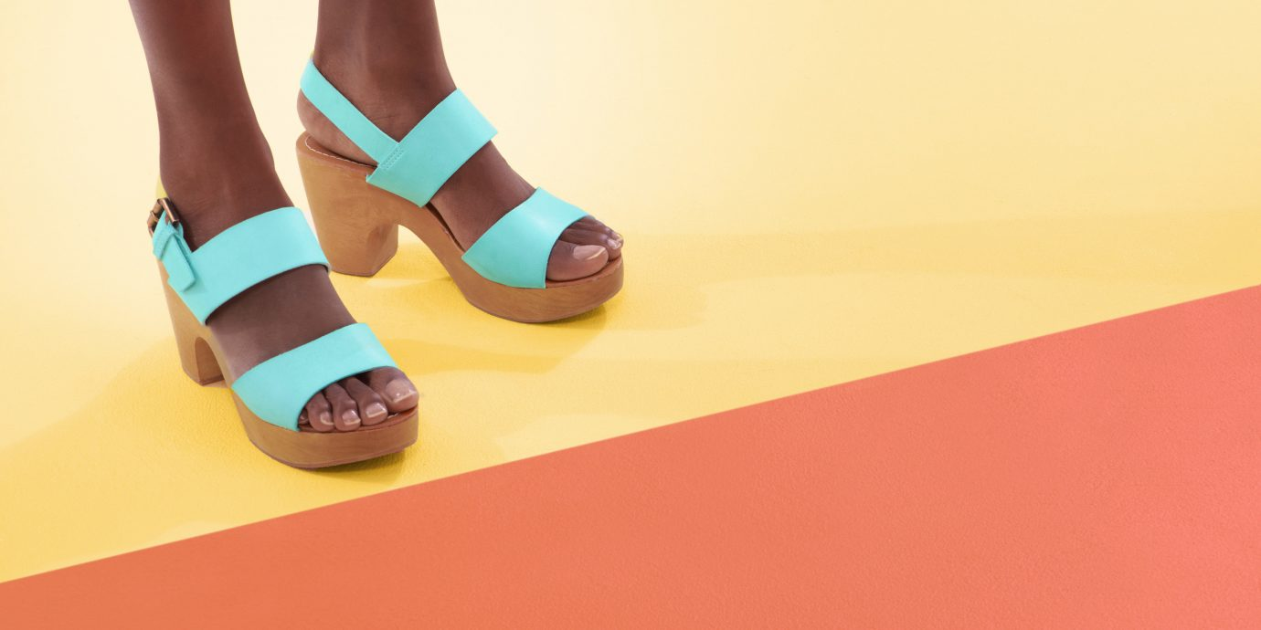 Spring Travel Style + Design Travel Shop footwear person yellow shoe sandal outdoor shoe leg human leg ankle product design flooring foot floor ballet flat orange toe feet