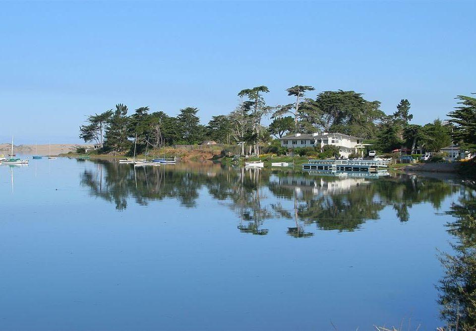 water Nature tree sky Lake shore pond reservoir Lagoon marina dock waterway Sea wetland surrounded day