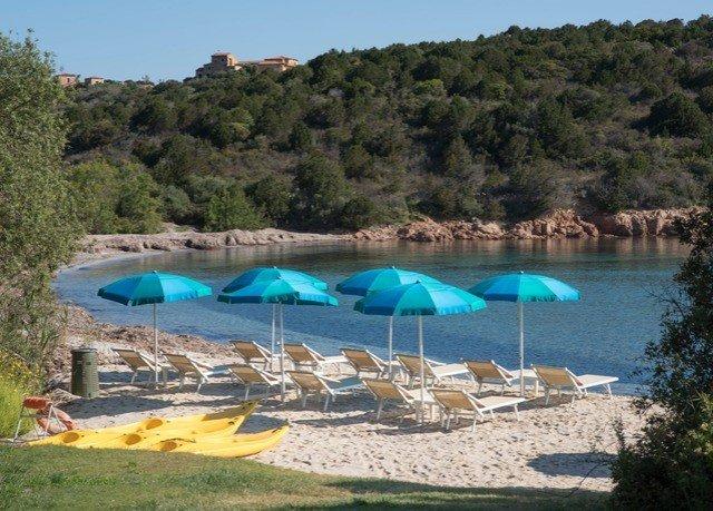 umbrella tree water chair sky lawn swimming pool Resort Lagoon Lake blue Villa camping shore shade day set lined swimming