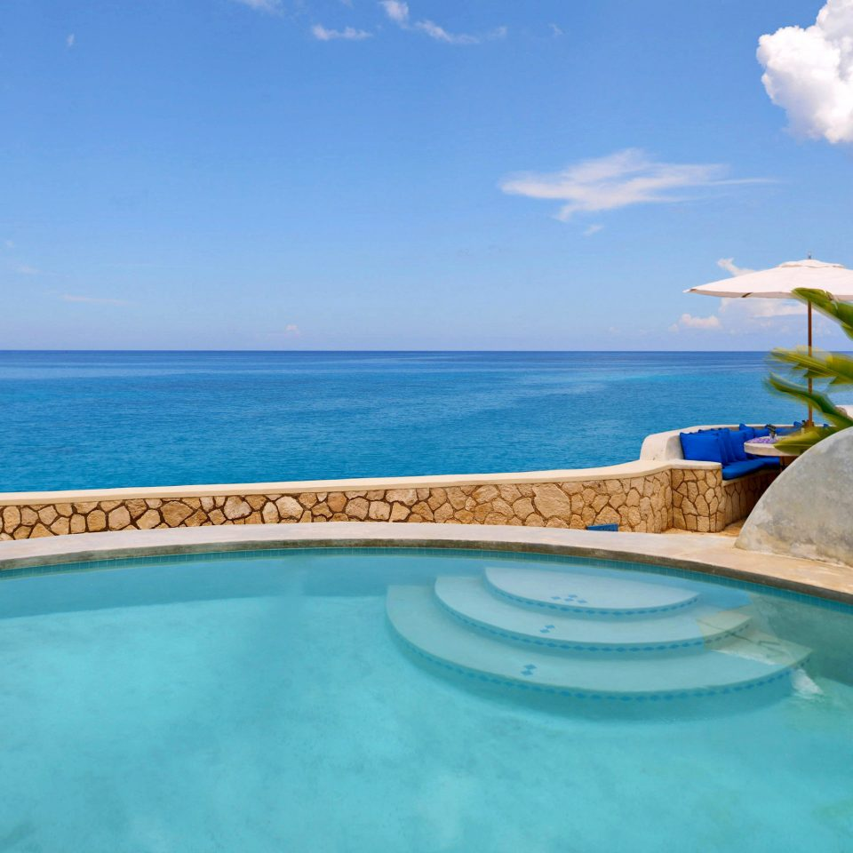 Luxury Pool Romance Romantic Scenic views Trip Ideas Tropical Waterfront sky water swimming pool property caribbean Nature Sea Ocean Villa Lagoon shore Resort swimming