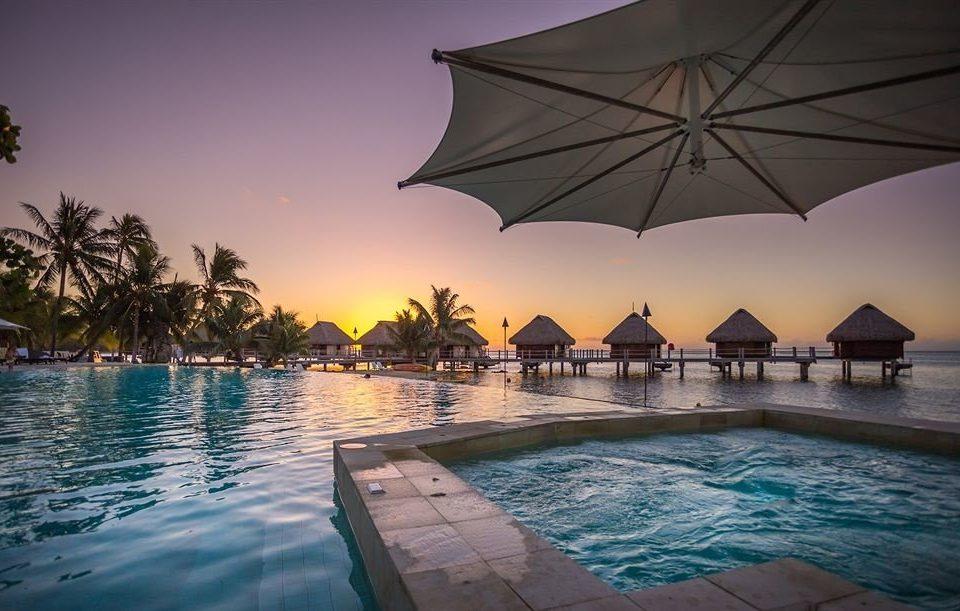 umbrella water accessory Nature swimming pool Sea Ocean evening dusk Sunset Resort sunlight Lagoon swimming shore day