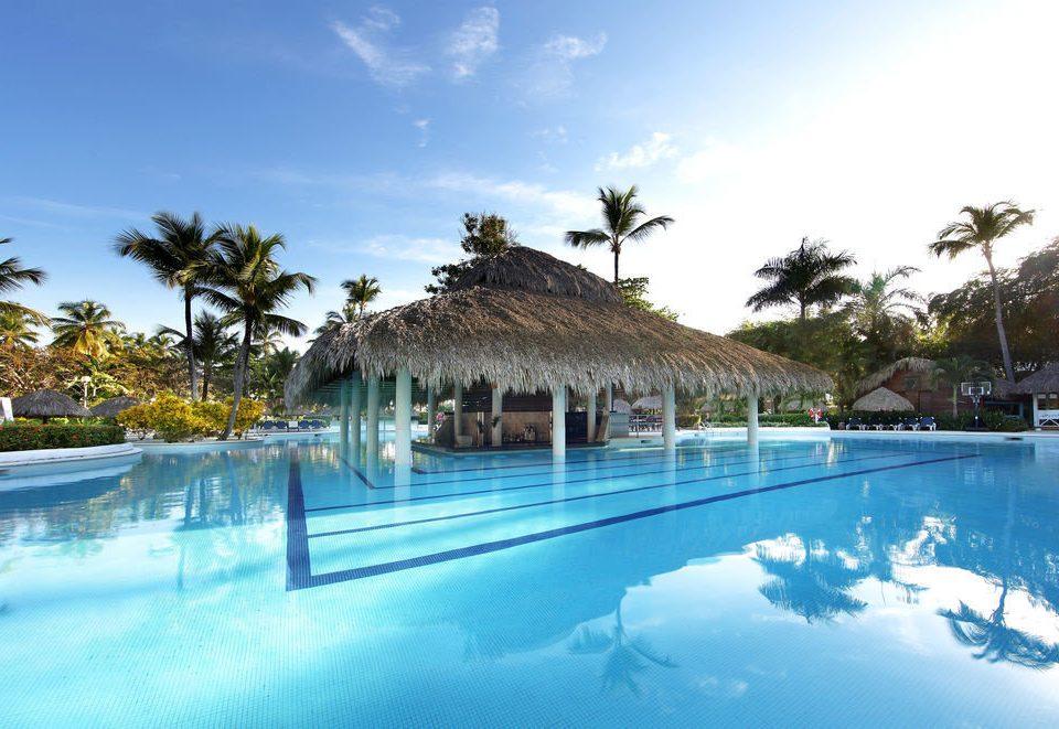 sky tree swimming pool Resort property leisure Pool Nature Lagoon resort town caribbean Villa arecales blue swimming