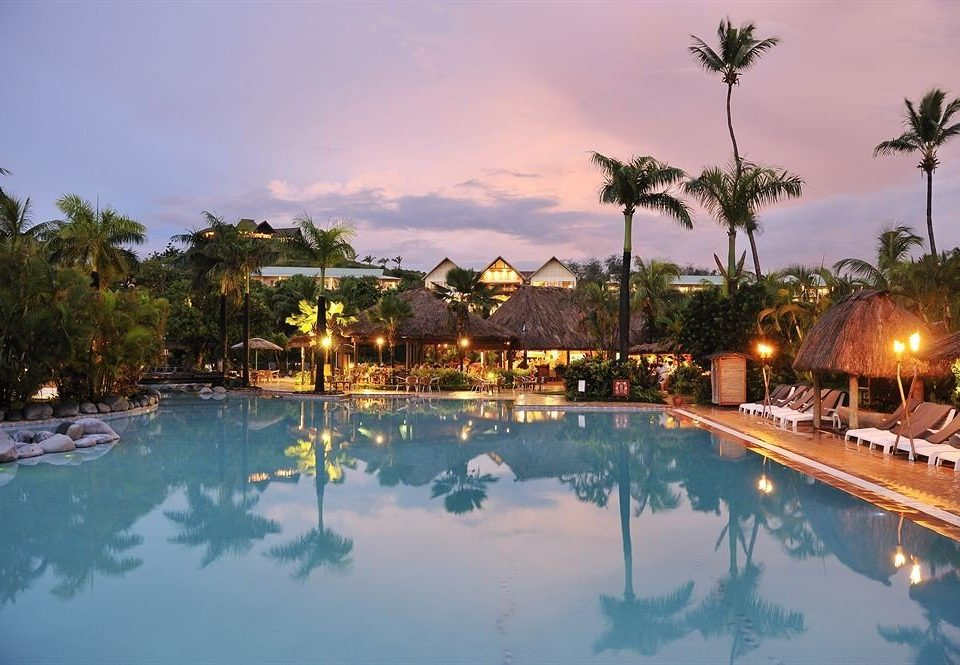 tree sky swimming pool Resort property leisure Nature resort town Lagoon shore surrounded day
