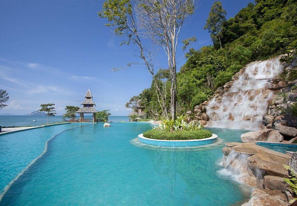 tree sky water swimming pool Nature Resort Sea resort town Lagoon surrounded